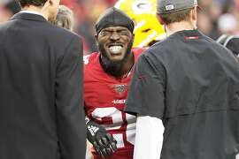 San Francisco 49ers running back Tevin Coleman, center, reacts after being injured against the Green Bay Packers during the first half of the NFL NFC Championship football game Sunday, Jan. 19, 2020, in Santa Clara, Calif. (AP Photo/Tony Avelar)