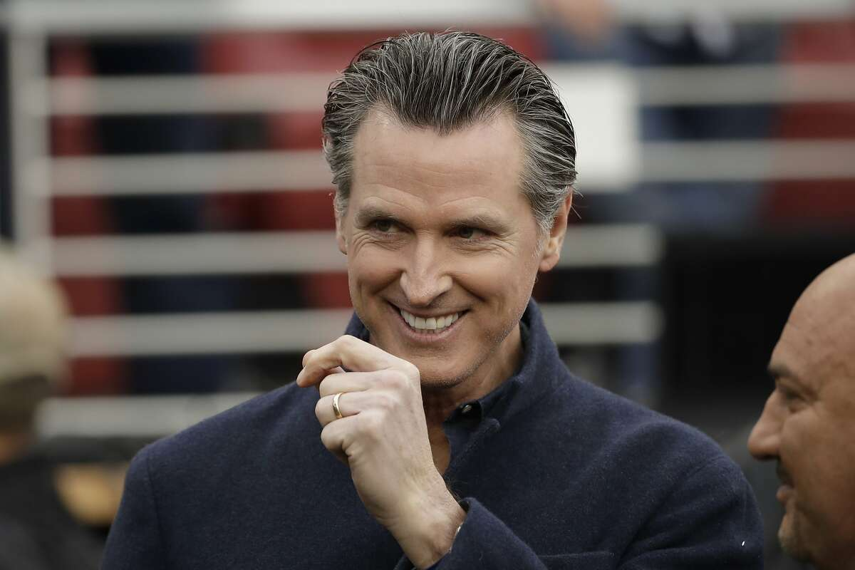 California Gov. Gavin Newsom talks with Jay Glazer, right, before the NFL NFC Championship football game between the San Francisco 49ers and the Green Bay Packers Sunday, Jan. 19, 2020, in Santa Clara, Calif. (AP Photo/Marcio Jose Sanchez)