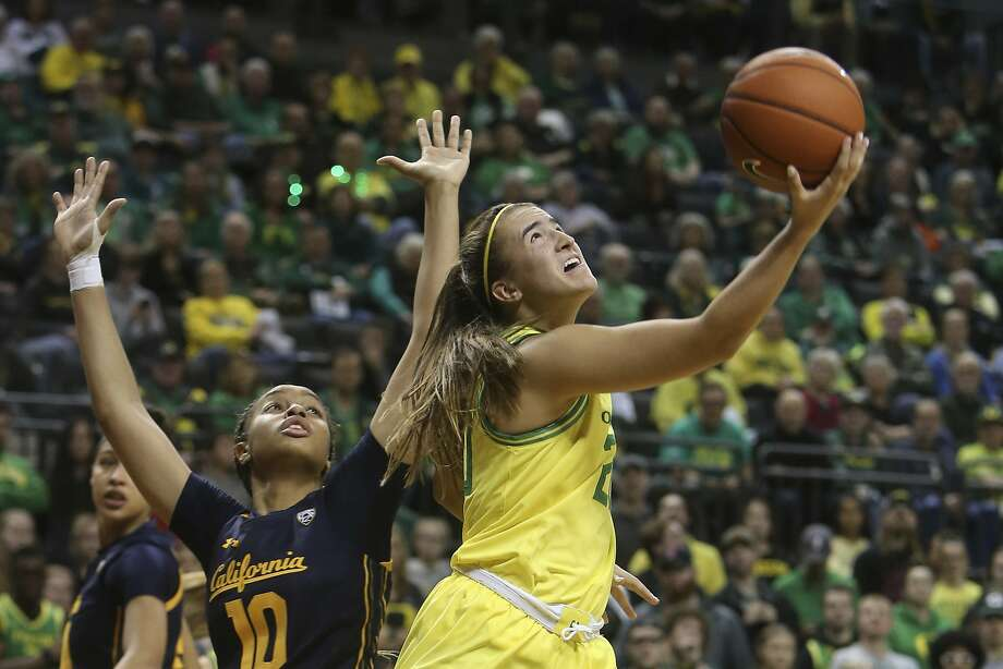 Oregon's Sabrina Ionescu, right, shots a reverse layup against California's Jazlen Green during the third quarter of an NCAA college basketball game in Eugene, Ore. Sunday Jan. 19, 2020. [Chris Pietsch/The Register-Guard via AP) Photo: Chris Pietsch / Associated Press