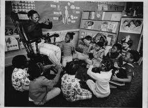 """Albany, New York - Former Public School #9, 333 Sheridan Avenue - Head Start program - Miss Patricia A. Oliver of Albany, parent volunteer, doing finger play """"Eency Weency Spider"""". March 31, 1977 (Bob Richey/Times Union Archive)"""