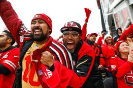 Kekoa Estrada (left) and Wayne Patrick Brown (right) cheer during the first quarter of the NFC Championship game between the San Francisco 49ers and the Green Bay Packers at Levi�s Stadium on Sunday, Jan. 19, 2020 in Santa Clara, California.