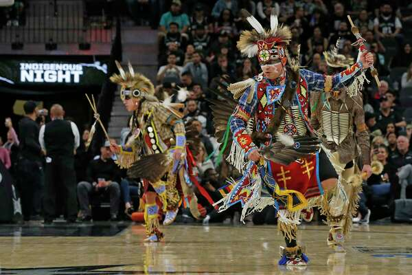 Members of Tap Pilam Coahuiltecan Nation, who lived on the land before it was San Antonio, perform at the Spurs-Heat game as part of the NBA's first Indigenous Night on Sunday.