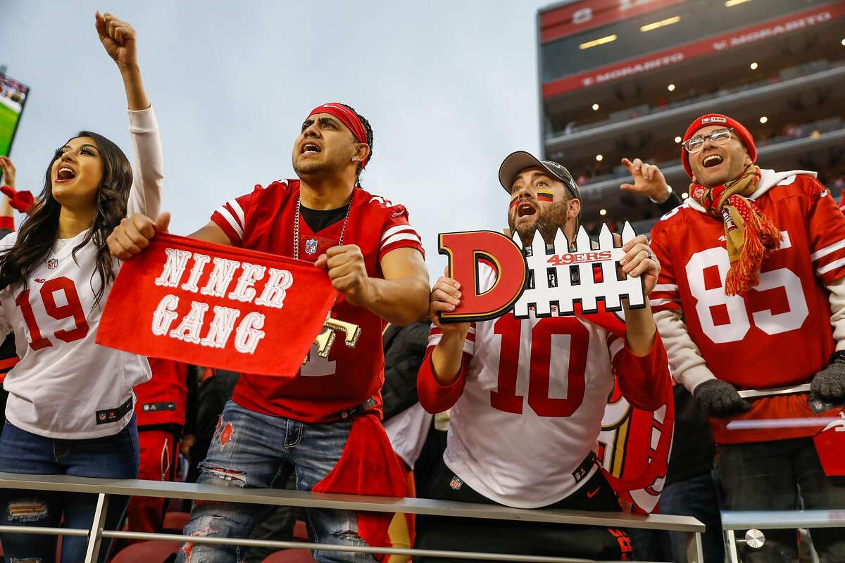 (L-r) Brianna Ruiz, Cesar Ruiz and Matt Bridges cheer during the final minute of the first half of the NFC Championship game between the San Francisco 49ers and the Green Bay Packers at Levi�s Stadium on Sunday, Jan. 19, 2020 in Santa Clara, California.
