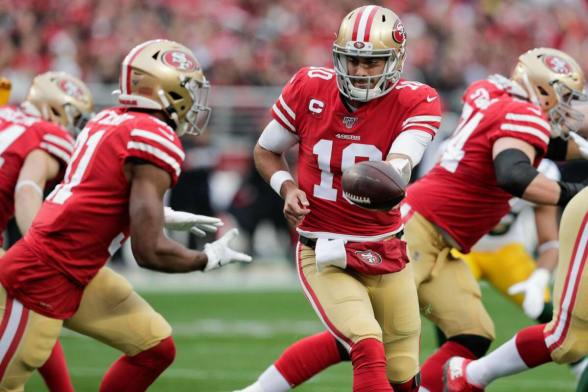 San Francisco 49ers' Jimmy Garoppolo hands off to Raheem Mostert in the first quarter during the NFC Championship game between the San Francisco 49ers and the Green Bay Packers at Levi's Stadium on Sunday, Jan. 19, 2020 in Santa Clara, Calif.