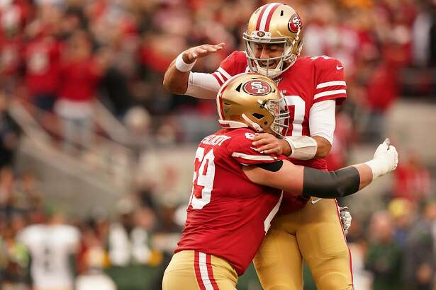 SANTA CLARA, CALIFORNIA - JANUARY 19: Jimmy Garoppolo #10 of the San Francisco 49ers reacts to a touchdown run by Raheem Mostert #31 in the first quarter against the Green Bay Packers during the NFC Championship game at Levi's Stadium on January 19, 2020 in Santa Clara, California. (Photo by Thearon W. Henderson/Getty Images)
