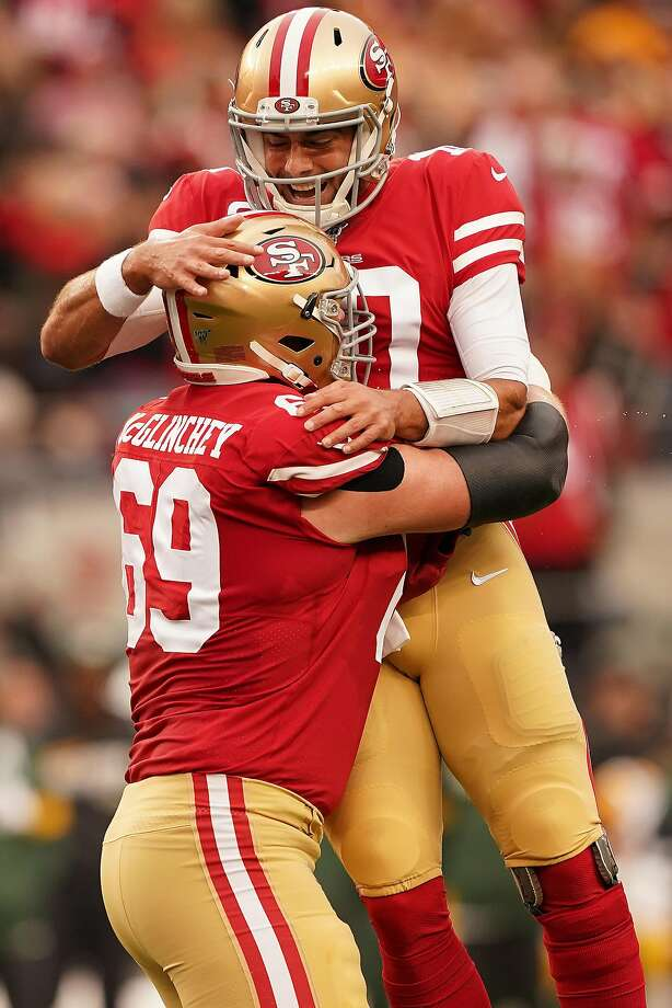 SANTA CLARA, CALIFORNIA - JANUARY 19: Jimmy Garoppolo #10 of the San Francisco 49ers reacts to a touchdown run by Raheem Mostert #31 in the first quarter against the Green Bay Packers during the NFC Championship game at Levi's Stadium on January 19, 2020 in Santa Clara, California. (Photo by Thearon W. Henderson/Getty Images) Photo: Thearon W. Henderson / Getty Images