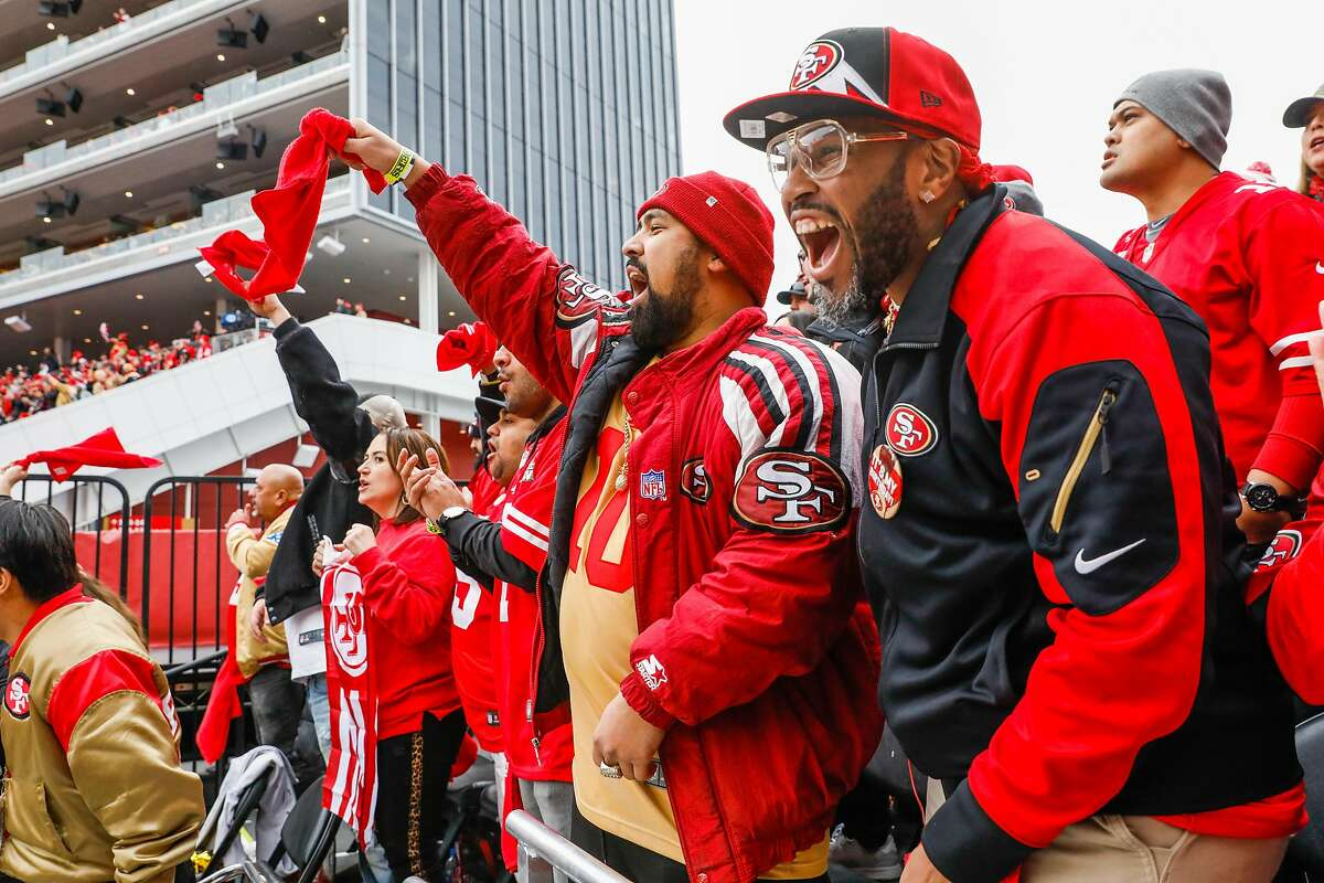 Kekoa Estrada (center) and Wayne Patrick Brown (right) cheer during the first quarter of the NFC Championship game between the San Francisco 49ers and the Green Bay Packers at Levi�s Stadium on Sunday, Jan. 19, 2020 in Santa Clara, California.