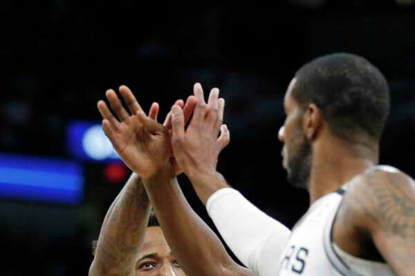 DeMar DeRozan #10 of the San Antonio Spurs gets congratulations from LaMarcus Aldridge #12 in first half action on Sunday, January 19, 2020 at At&T Center.