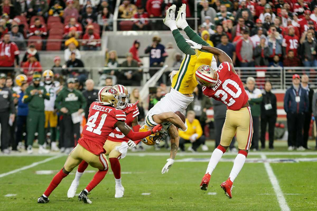 San Francisco 49ers' Jimmie Ward upends Green Bay Packers' Allen Lazard in the second quarter during the NFC Championship game between the San Francisco 49ers and the Green Bay Packers at Levi's Stadium on Sunday, Jan. 19, 2020 in Santa Clara, Calif.