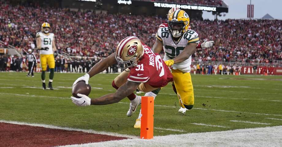 San Francisco 49ers running back Raheem Mostert (31) scores in front of Green Bay Packers free safety Darnell Savage (26) during the first half of the NFL NFC Championship football game Sunday, Jan. 19, 2020, in Santa Clara, Calif. (AP Photo/Tony Avelar) Photo: Tony Avelar/Associated Press