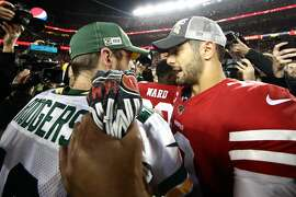 Aaron Rodgers and Jimmy Garoppolo chat at the conclusion of the 2020 NFC Championship Game.