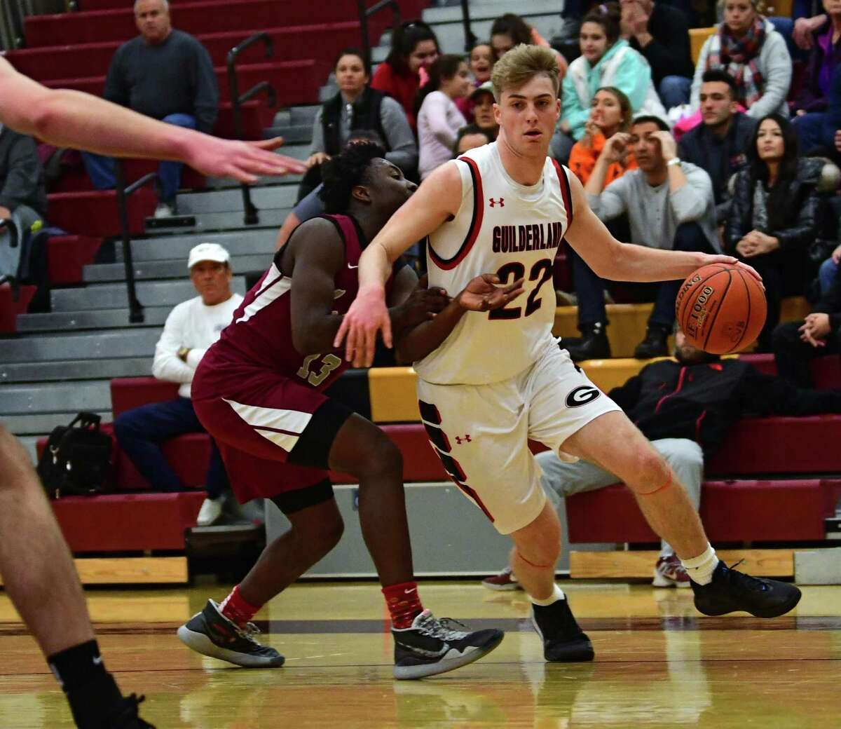 Guilderland's Ryan Teaney drives to the hoop against Watervliet's Marcel Robinson during a basketball game on Tuesday, Dec. 31, 2019 in Colonie, N.Y. (Lori Van Buren/Times Union)