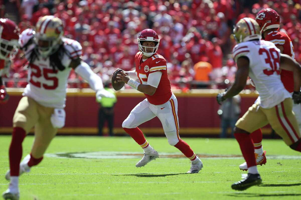KANSAS CITY, MO - SEPTEMBER 23: Kansas City Chiefs quarterback Patrick Mahomes (15) scrambles and looks for a receiver in the first quarter of a week 3 NFL game between the San Francisco 49ers and Kansas City Chiefs on September 23, 2018 at Arrowhead Stadium in Kansas City, MO. (Photo by Scott Winters/Icon Sportswire via Getty Images)
