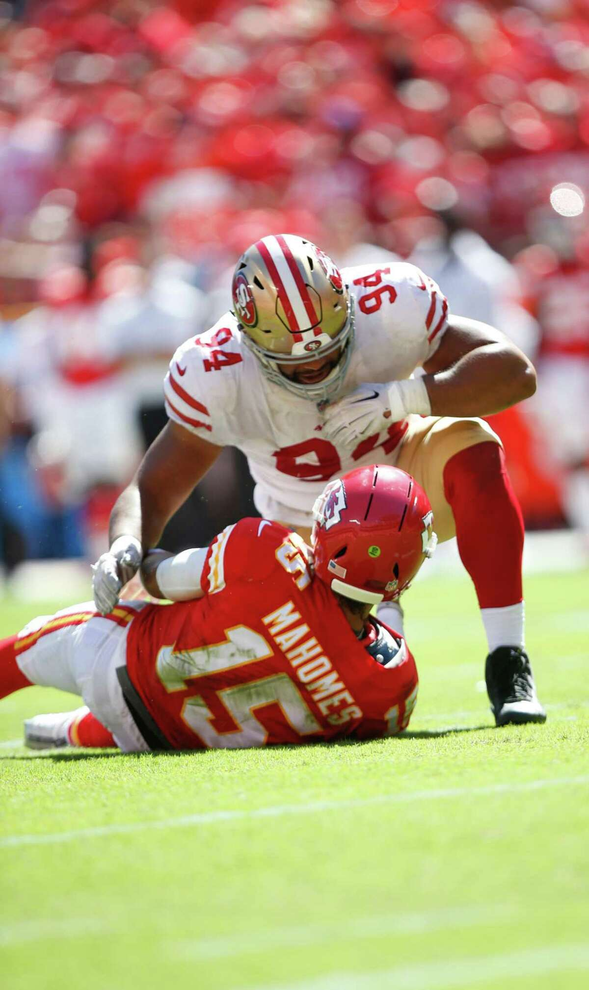 KANSAS CITY, MO - SEPTEMBER 23: Solomon Thomas #94 of the San Francisco 49ers looks down on Patrick Mahomes #15 of the Kansas City Chiefs after knocking him down during the game at Arrowhead Stadium on September 23, 2018 in Kansas City, Missouri. The Chiefs defeated the 49ers 38-27. (Photo by Michael Zagaris/San Francisco 49ers/Getty Images)