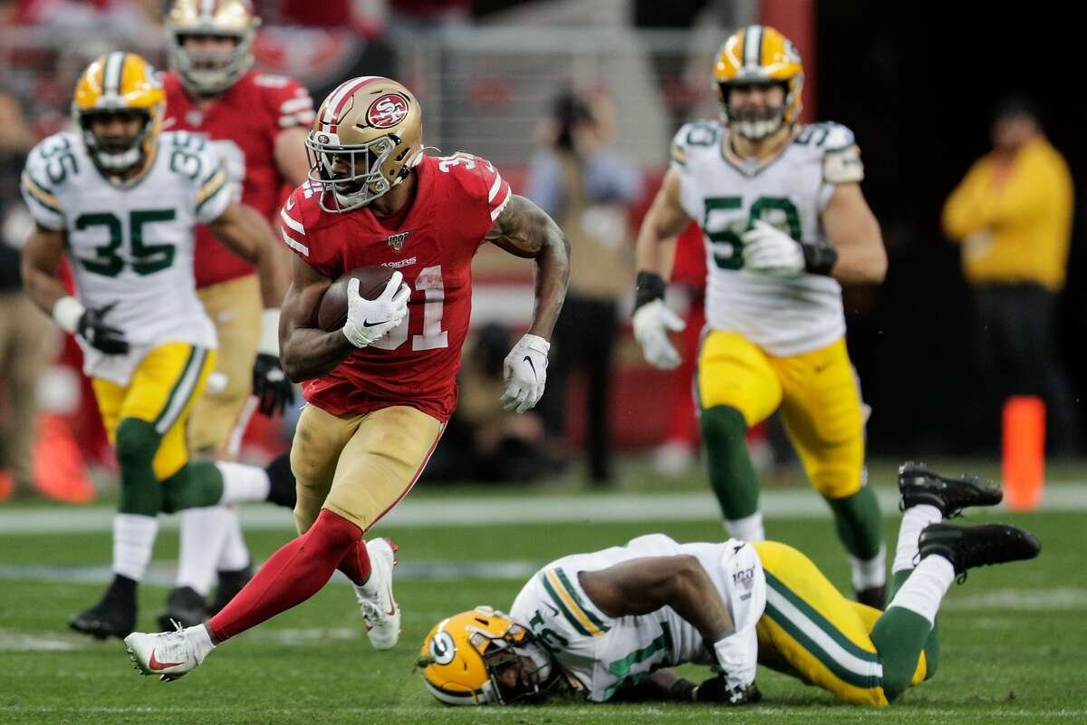 San Francisco 49ers' Raheem Mostert runs for a gain in the second quarter during the NFC Championship game between the San Francisco 49ers and the Green Bay Packers at Levi's Stadium on Sunday, Jan. 19, 2020 in Santa Clara, Calif.
