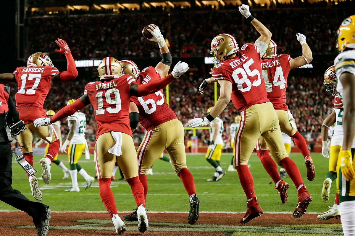 San Francisco 49ers' Ben Garland spikes a Raheem Mostert third quarter touchdown ball during the NFC Championship game between the San Francisco 49ers and the Green Bay Packers at Levi's Stadium on Sunday, Jan. 19, 2020 in Santa Clara, Calif.