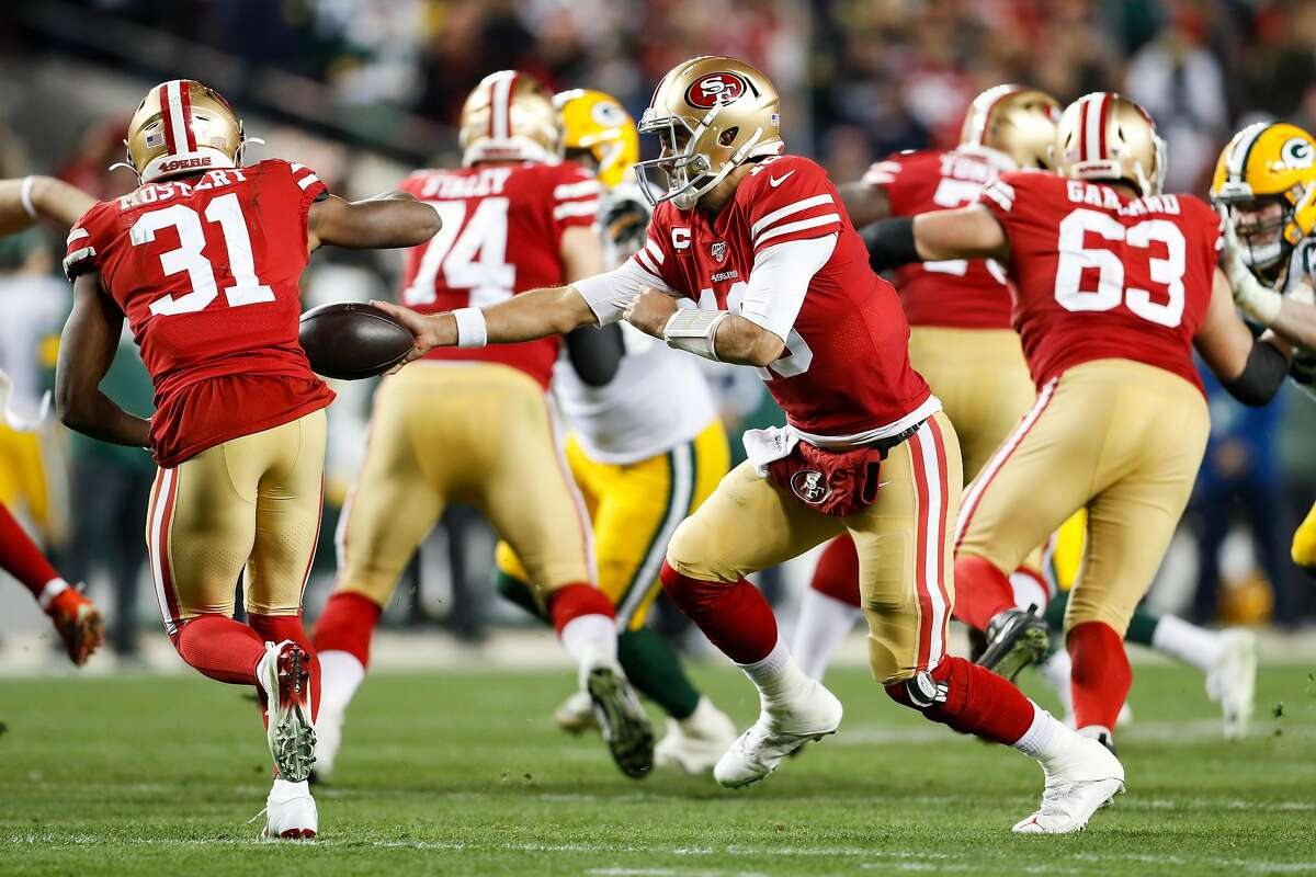 San Francisco 49ers' Jimmy Garoppolo hands off to San Francisco 49ers Raheem Mostert in the third quarter during the NFC Championship game between the San Francisco 49ers and the Green Bay Packers at Levi's Stadium on Sunday, Jan. 19, 2020 in Santa Clara, Calif.