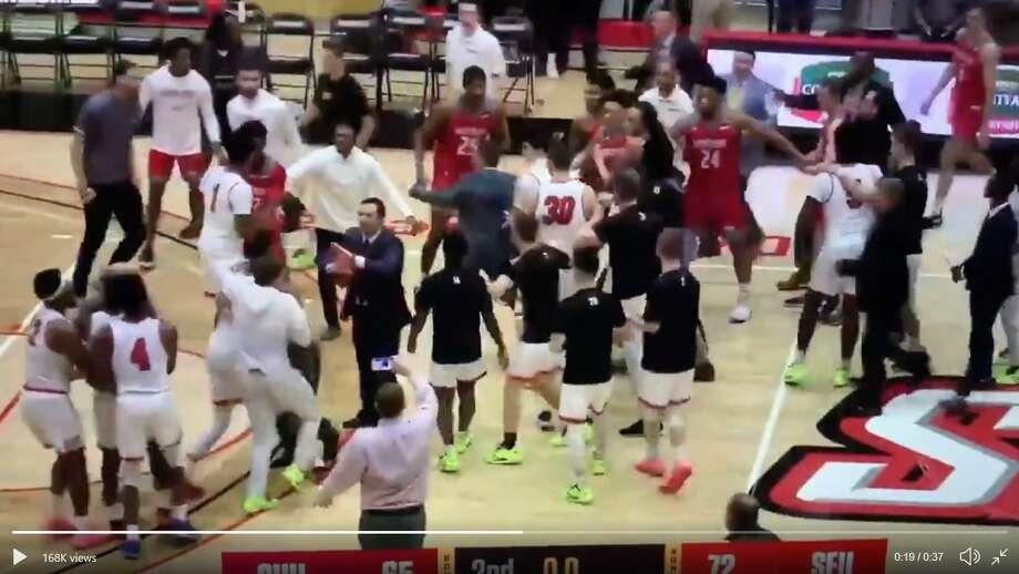 Screenshot of postgame altercation between Sacred Heart and Saint Francis men's basketball teams on Saturday. Photo: Screenshot /Twitter /