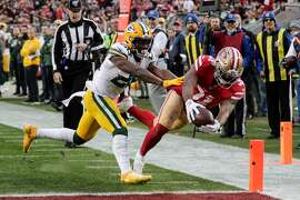 San Francisco 49ers' Raheem Mostert reaches for a touchdown while being chased by Green Bay Packers' Darnell Savage in the second quarter during the NFC Championship game between the San Francisco 49ers and the Green Bay Packers at Levi's Stadium on Sunday, Jan. 19, 2020 in Santa Clara, Calif.