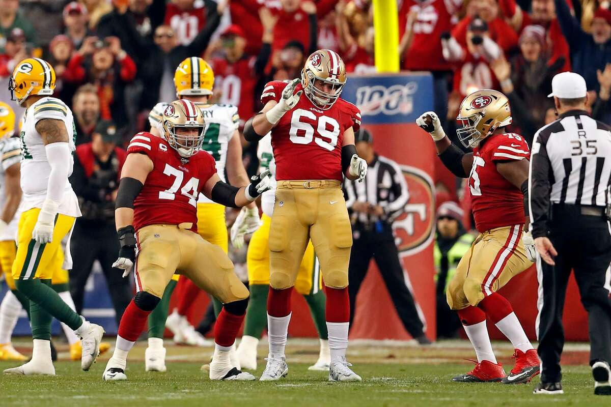 San Francisco 49ers' Joe Staley, Mike McGlinchey and Laken Tomlinson dance after Raheem Mostert's 3rd touchdown of the game during 37-20 win over Green Bay Packers during NFC Championship Game at Levi's Stadium in Santa Clara, Calif., on Sunday, January 19, 2020.