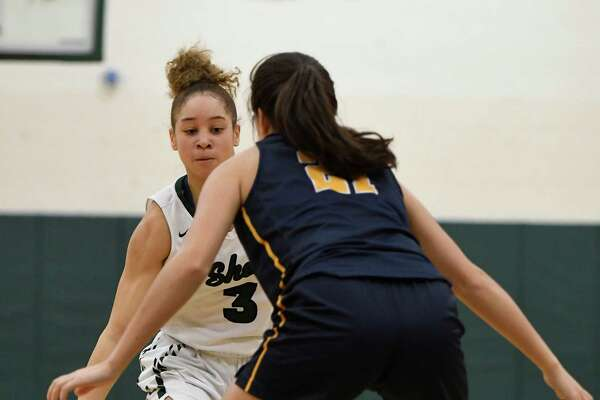 Shenendehowa's Simone Walker attempts to move the ball past Our Lady of Lourdes' Mikayla Russo during a game at Shenendehowa High School in Clifton Park, N.Y., on Sunday, Jan. 19, 2020. (Jenn March, Special to the Times Union)