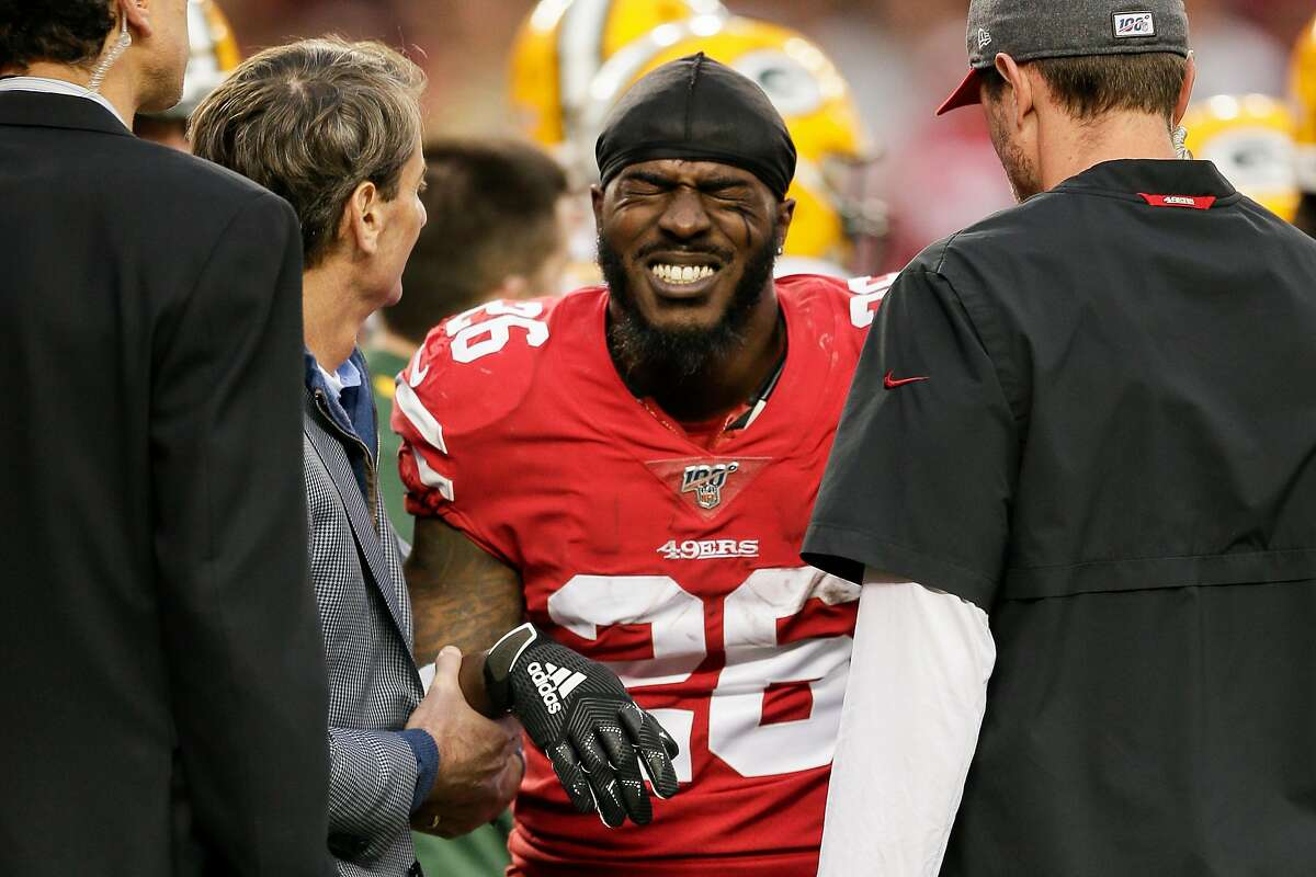 San Francisco 49ers' Tevin Coleman reacts to pain after sustaining an arm injury in the second quarter during the NFC Championship game between the San Francisco 49ers and the Green Bay Packers at Levi's Stadium on Sunday, Jan. 19, 2020 in Santa Clara, Calif.