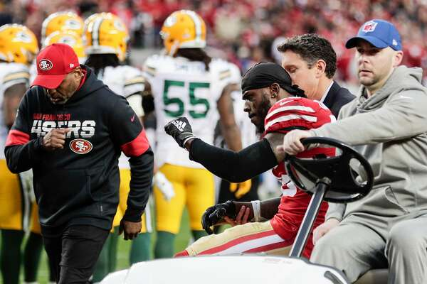 San Francisco 49ers' Tevin Coleman raises his left arm as he taken off the field after sustaining an injury in the second quarter during the NFC Championship game between the San Francisco 49ers and the Green Bay Packers at Levi's Stadium on Sunday, Jan. 19, 2020 in Santa Clara, Calif.