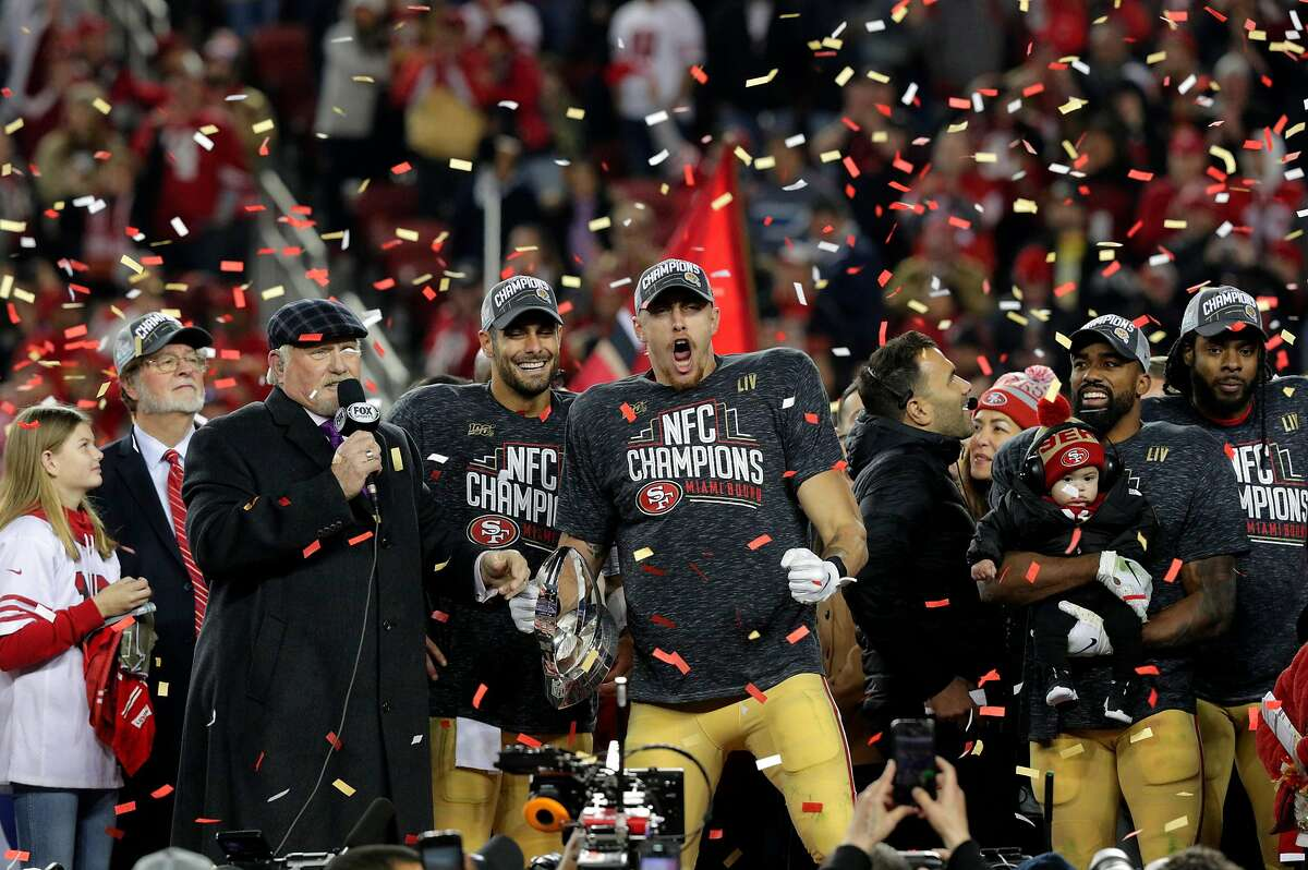 George Kittle celebrates on stage during the trophy ceremony after the San Francisco 49ers defeated the Green Bay Packers 37-20, in the NFC Championship Game at Levi's Stadium in Santa Clara , Calif., on Sunday, January 19, 2020. The 49ers will advance to play in Super Bowl LIV