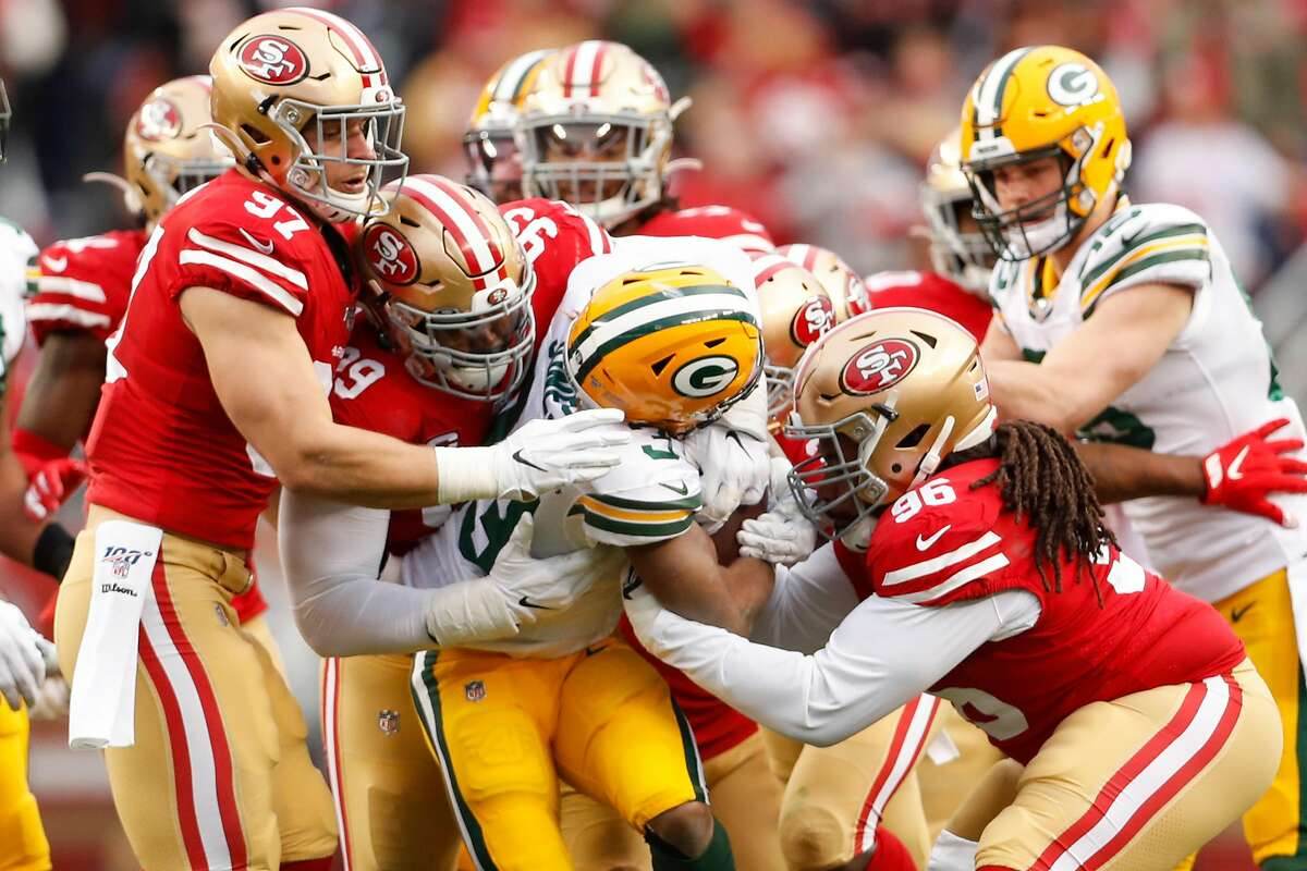 San Francisco 49ers� Nick Bosa, DeForest Buckner, and Sheldon Day stop Green Bay Packers� Aaron Jones at the line in the first quarter during the NFC Championship game between the San Francisco 49ers and the Green Bay Packers at Levi�s Stadium on Sunday, Jan. 19, 2020 in Santa Clara, Calif.