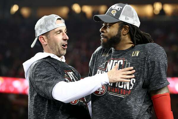 SANTA CLARA, CALIFORNIA - JANUARY 19: Head coach Kyle Shanahan of the San Francisco 49ers celebrates with Richard Sherman #25 after winning the NFC Championship game against the Green Bay Packers at Levi's Stadium on January 19, 2020 in Santa Clara, California. The 49ers beat the Packers 37-20. (Photo by Ezra Shaw/Getty Images)