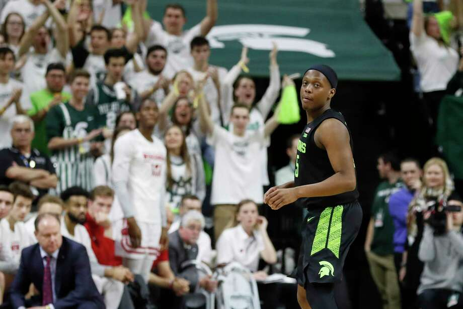 Fans cheer after Michigan State guard Cassius Winston attained the all-time Big Ten and Michigan State records for assists during the second half of an NCAA college basketball game against Wisconsin, on Friday, in East Lansing. (AP Photo/Carlos Osorio) / Copyright 2020 The Associated Press. All rights reserved.