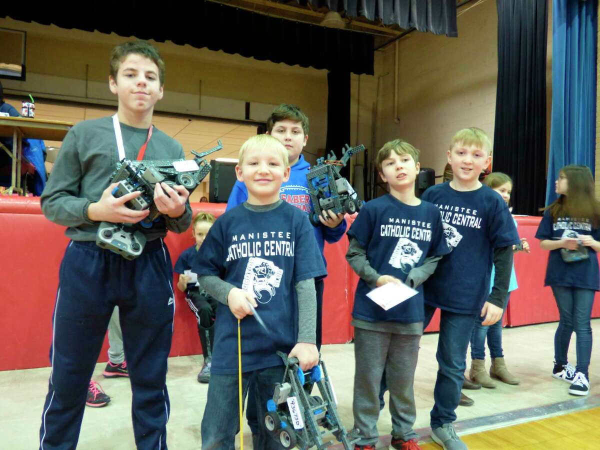 Students from Manistee Catholic Central showoff their robotic creations. (News Advocate/Scott Fraley)