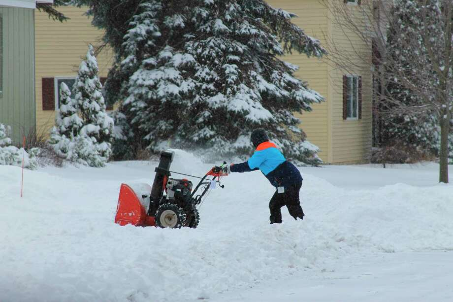 A snow blower makes quick work of winter snows. (Scott Fraley/News Advocate)