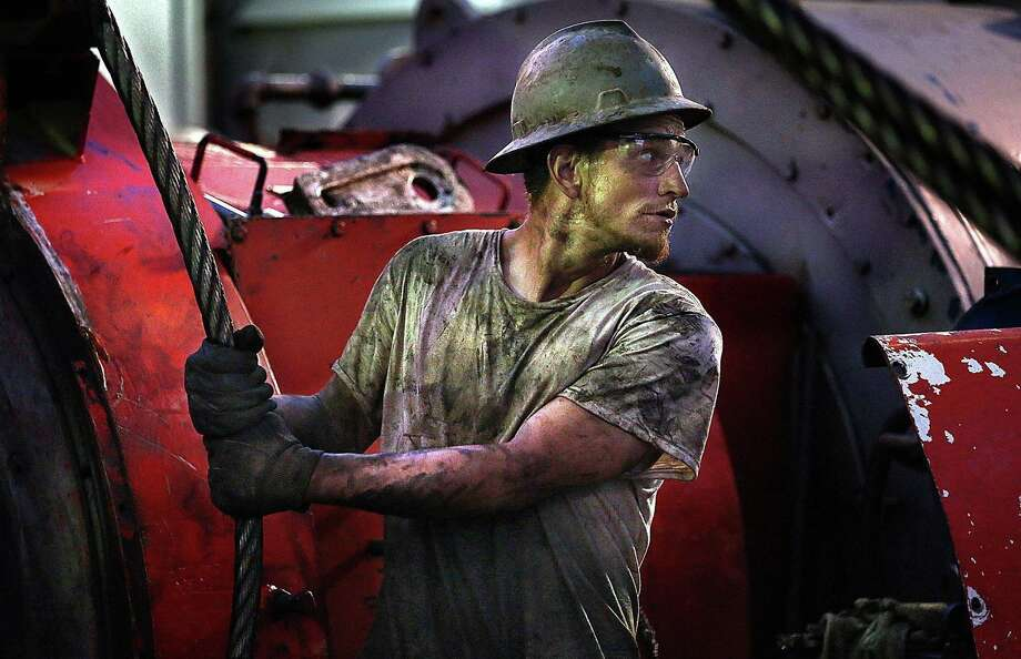 Midland oil company Diamondback Energy and Austin oil company Parsley Energy confirmed plans to cut back the number of drilling rig and hydraulic fracturing crews in the shale play. Photo: Jim Gehrz,  MBR / McClatchy-Tribune News Service / Minneapolis Star Tribune