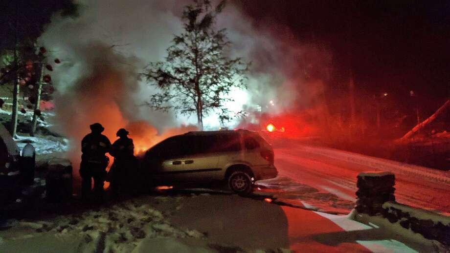 Firefighters not only battled a vehicle fire, but falling snow on Saturday night on Dec. 19, 2020. In the midst of the snowstorm, the Danbury Fire Department was summoned to a car fire in the Lake Waubeeka community, reportedly near a house. Photo: Danbury Fire Department Photo