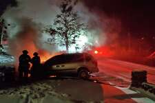 Firefighters not only battled a vehicle fire, but falling snow on Saturday night on Dec. 19, 2020. In the midst of the snowstorm, the Danbury Fire Department was summoned to a car fire in the Lake Waubeeka community, reportedly near a house.