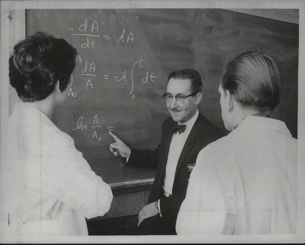 Dr. Joseph Marcelli, chairman of Chemistry Department at Hudson Valley Community College with Linda Martin of Voorheesville and Paul Weymouth of Gloversville on April 4, 1965.