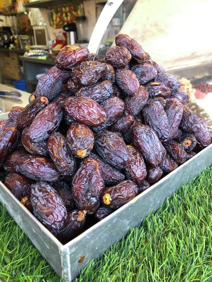 Dates, which are a current food trend, are high in several nutrients, fiber, and antioxidants, all of which may provide health benefits ranging from improved digestion to a reduced risk of disease. Dates are grown in warm climates, like that of the Middle East, where they are a staple. These dates were sold at an outdoor market in Jaffa, an ancient port city in the southern and oldest part of Tel Aviv, Israel. Photo: Elise Sullivan / / Connecticut Post