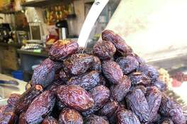 Dates, which are a current food trend, are high in several nutrients, fiber, and antioxidants, all of which may provide health benefits ranging from improved digestion to a reduced risk of disease. Dates are grown in warm climates, like that of the Middle East, where they are a staple. These dates were sold at an outdoor market in Jaffa, an ancient port city in the southern and oldest part of Tel Aviv, Israel.
