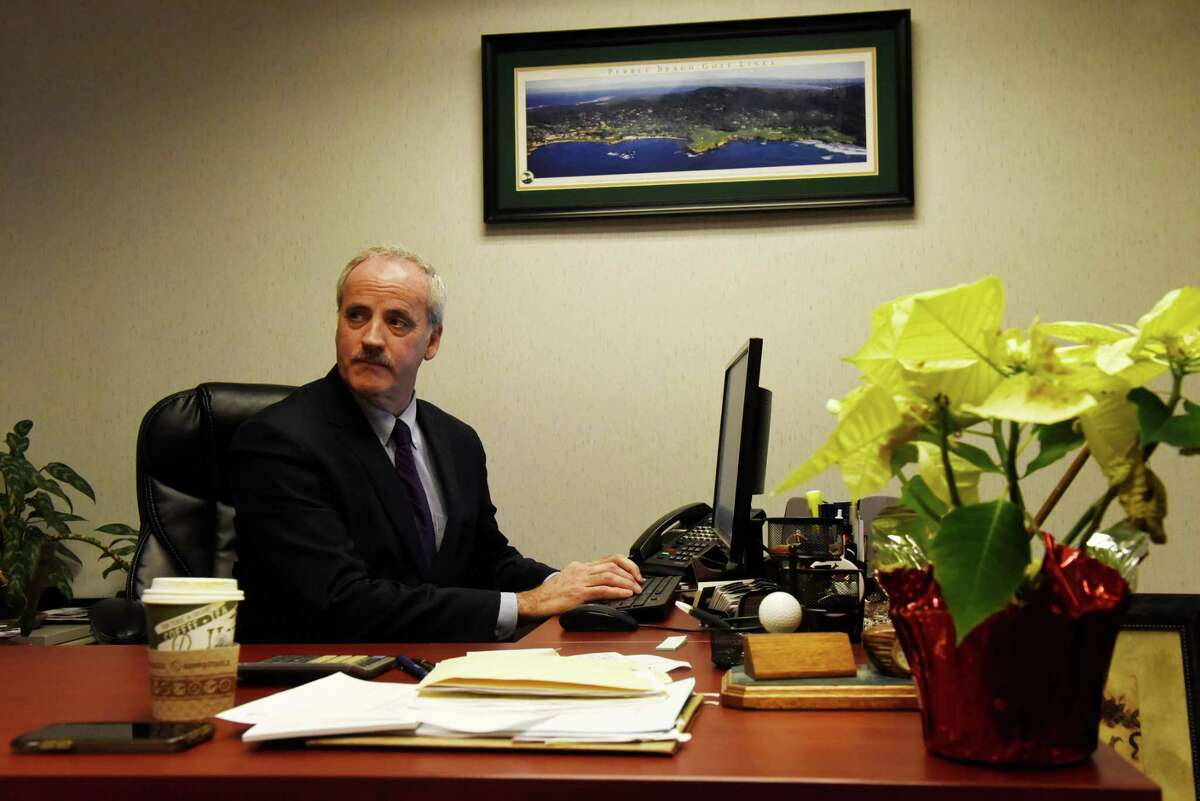 Jay Bernardo, president of Bernardo, Goldstein & Quinn bail bondsman agency, works at his office on Friday, Jan. 17, 2020, in Colonie, N.Y. The bail bond industry is facing huge losses in the wake of New York's bail reform law. (Will Waldron/Times Union)