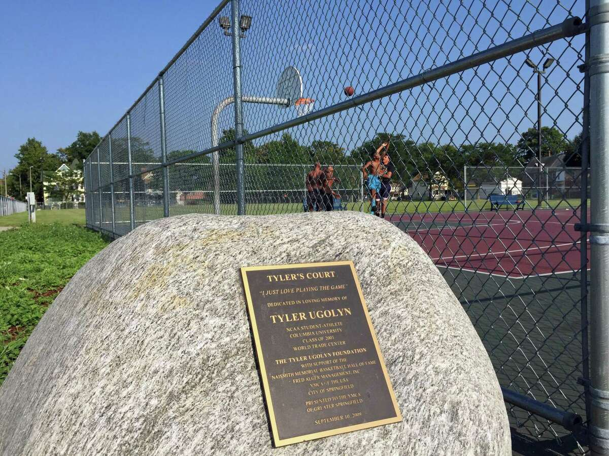 A memorial plaque at Tyler's Court in Springfield, Mass., is the cornerstone for a pickup basketball game. The court is named after Tyler Ugolyn, a Ridgefield resident and Our Lady of Fatima graduate who was killed in the Sept. 11 terrorist attacks.