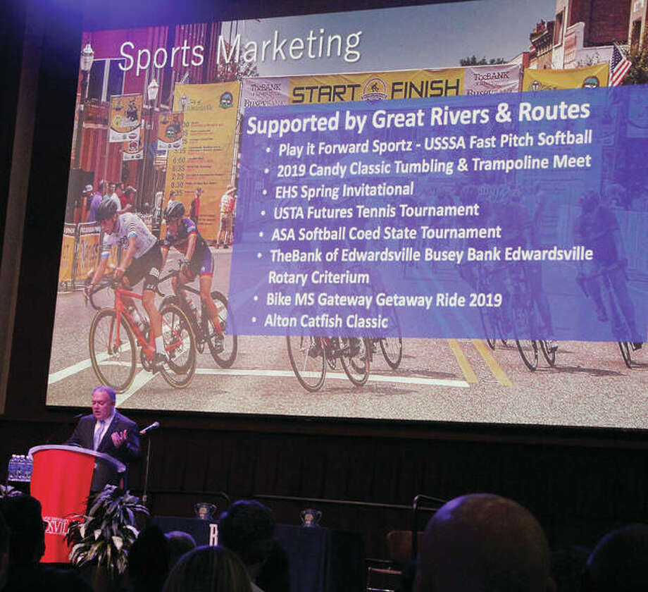 """Brett Stawar, president and CEO of the Great Rivers and Routes Tourism Bureau, speaks during the bureau's annual Tourism Summit Thursday at Southern Illinois University Edwardsville. The addition of three """"Local Landmarks"""" — The Wildey Theatre in Edwardsville, the Collinsville Catsup Bottle and the Ariston Café in Litchfield — were announced."""
