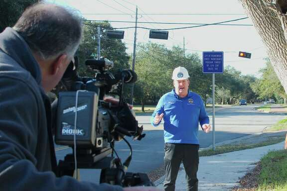 """Friendswood city communications specialist Jeff Newpher works the camera as Friendswood Mayor Mike Foreman speaks during the filming of """"Mayor Mike's Minute."""" The series has reached more than 40 segments since Foreman took office nearly two years ago."""