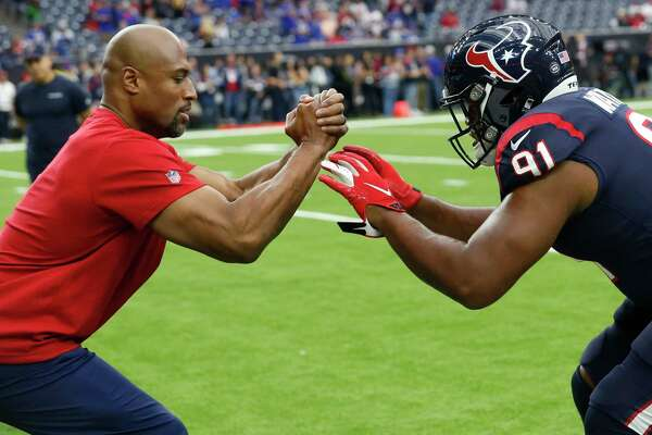 Houston Texans defensive line coach Anthony Weaver works with defensive lineman Carlos Watkins before an AFC wild card playoff game against the Buffalo Bills Saturday, Jan. 4, 2020, at NRG Stadium in Houston.