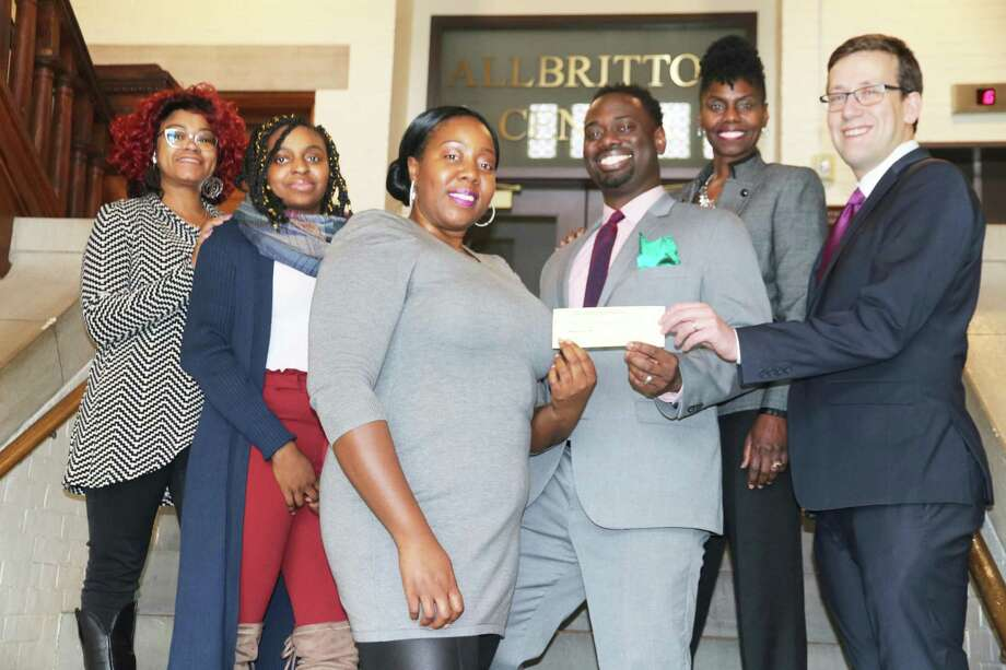 State Sen. Matt Lesser, far right, and state Rep. Quentin Phipps, middle, both D-Middletown, present members of the Martin Luther King Jr. Scholarship Committee of Greater Middletown with a donation Saturday at Wesleyan University. Committee members pictured, from right, are Trace Santoro, Deborah Cain, Brittany Hoggard and Yalonda Hart. Photo: Contributed Photo