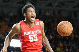 WICHITA, KS - JANUARY 18: Houston Cougars center Brison Gresham (55) yells after a dunk in the second half of an AAC basketball game between the Houston Cougars and Wichita State Shockers on January 18, 2020 at Charles Koch Arena in Wichita, KS. (Photo by Scott Winters/Icon Sportswire via Getty Images)