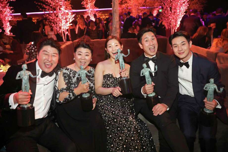 'Parasite' cast members Kang-Ho Song (from left), Jang Hye-jin, Park So-dam, Lee Sun Gyun and Choi Woo-shik celebrate their victory Sunday at the SAG Awards. Photo: Colin Young-Wolff /Associated Press / 2020 Invision