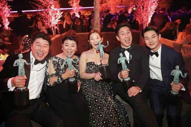 'Parasite' cast members Kang-Ho Song (from left), Jang Hye-jin, Park So-dam, Lee Sun Gyun and Choi Woo-shik celebrate their victory Sunday at the SAG Awards.
