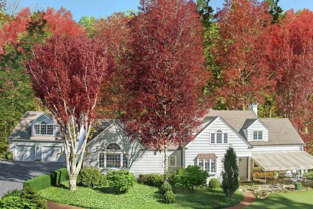 The light gray European-style cottage at 270 Newtown Turnpike in Wilton sits on a property of almost four acres.