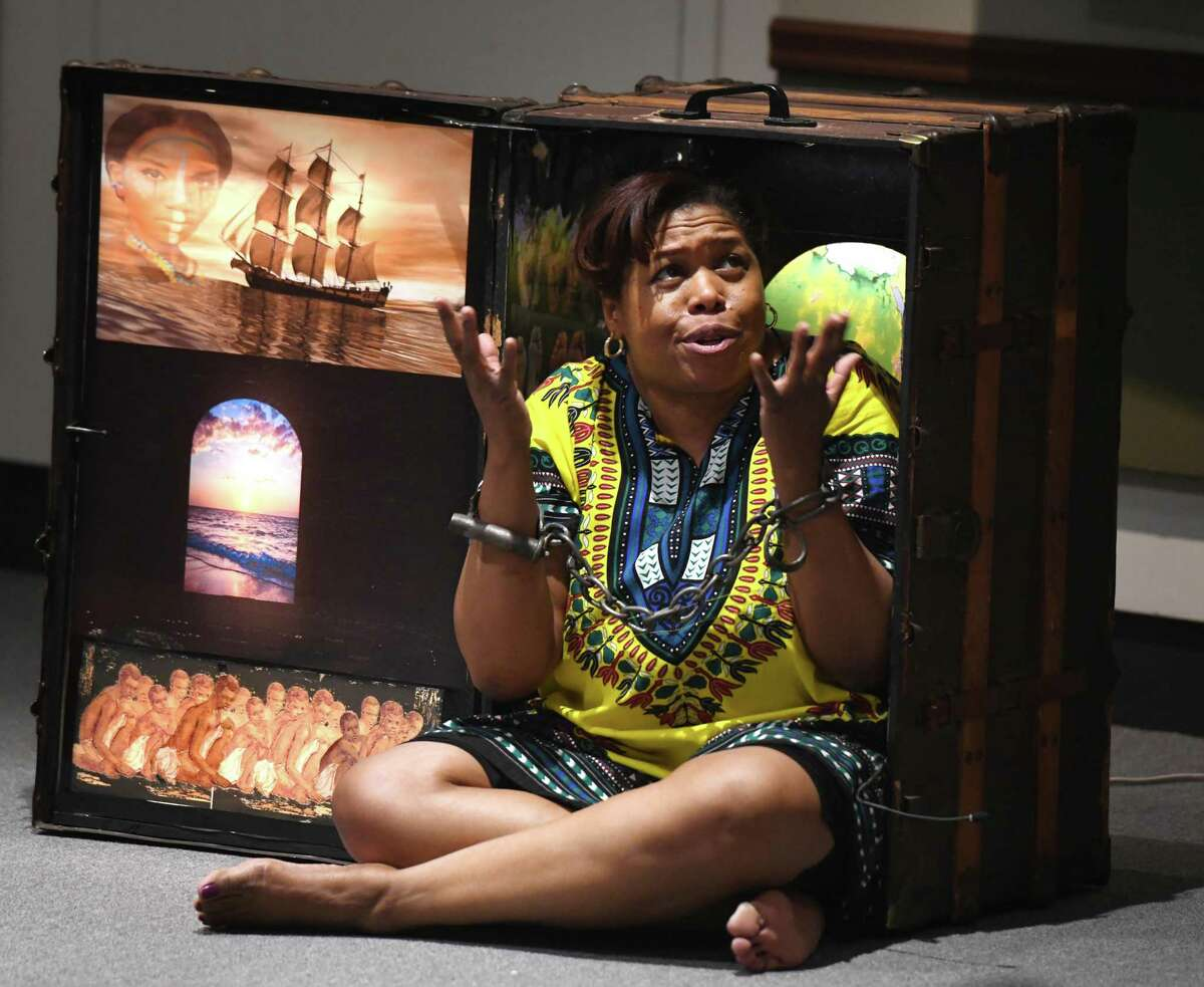 """Karima A. Robinson performs """"A So-Long Journey: The Early Years of Phillis Wheatley"""" during Martin Luther King Jr. Family Day at the Bruce Museum on Monday. Wheatley was the first published female African American poet and a key figure in the early abolitionist movement."""